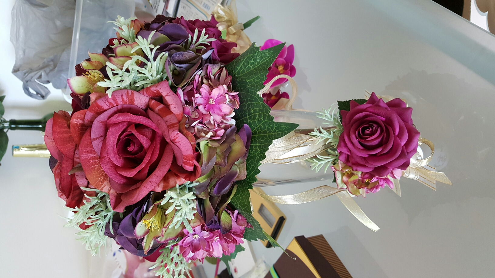 a set of bridal bouquet and boutonneire for groom image