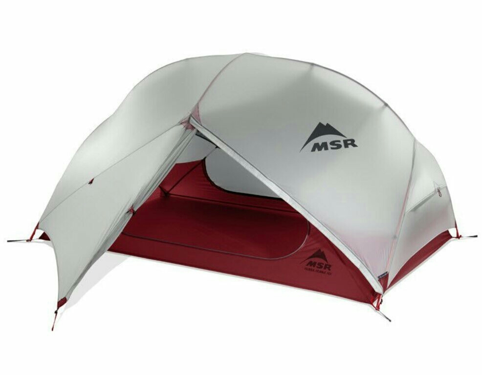 Camping tent with air mattresses and quilt for two image