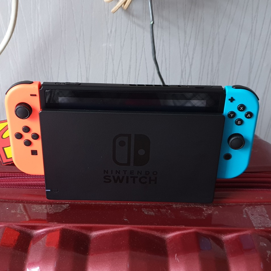 Nintendo Switch with 2 Joy Con and any game image