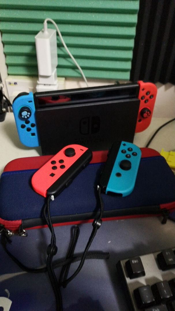 Nintendo Switch with 30+ popular games and 4 joycons + Dock + accessories image